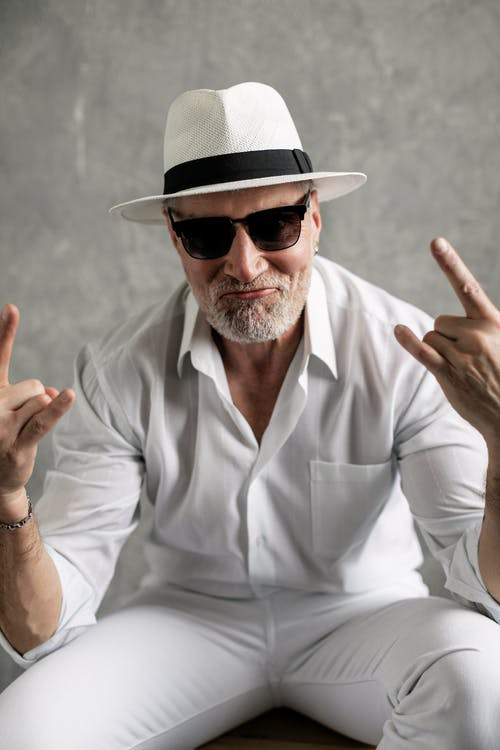 Elderly Man Doing Rock and Roll Sign