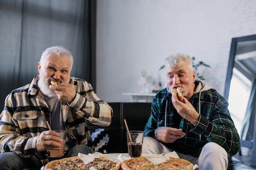 Elderly Men Eating Pizza