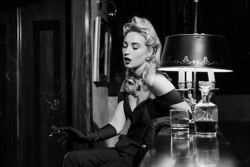 Photo of Woman Smoking on Counter