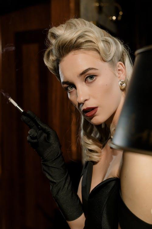 Photo of Beautiful Woman Holding Cigarette Holder