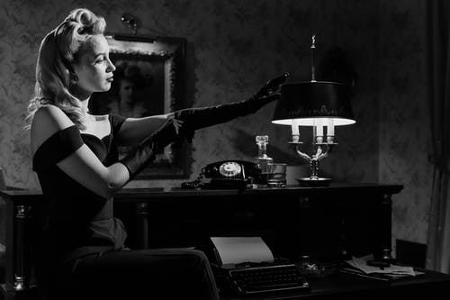 Photo of Elegant Woman Stretching Her Gloves