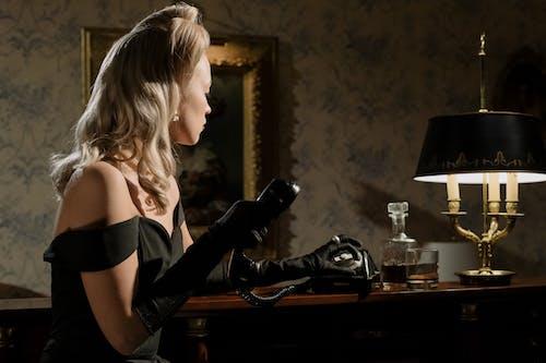 Photo of Woman Using Telephone