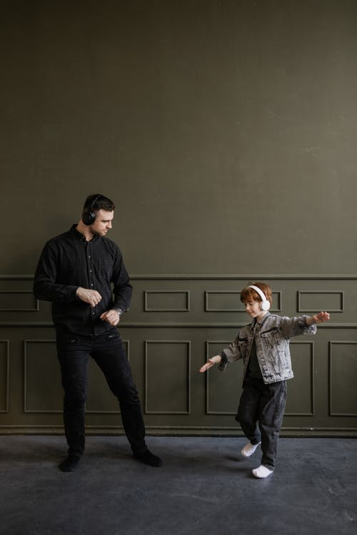 Father and Son Dancing while Listening to Music