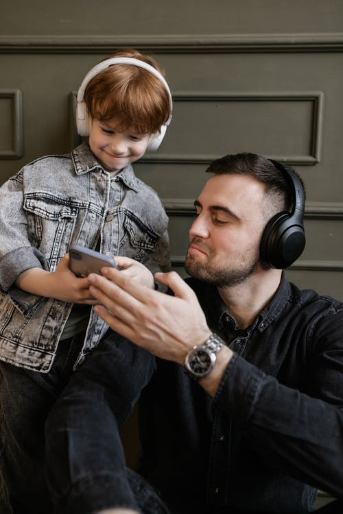 Father and Son Listening to Music