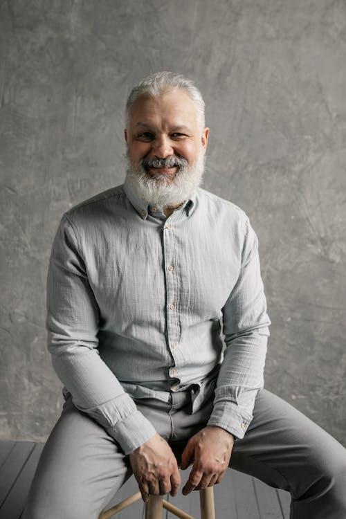 Elderly Man in Gray Long Sleeves Smiling