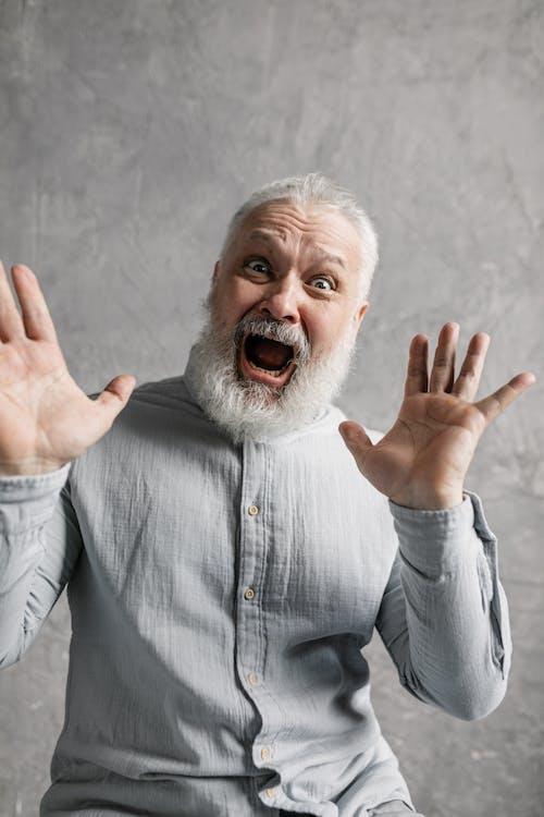 Elderly Man in Gray Long Sleeves Looking Surprised
