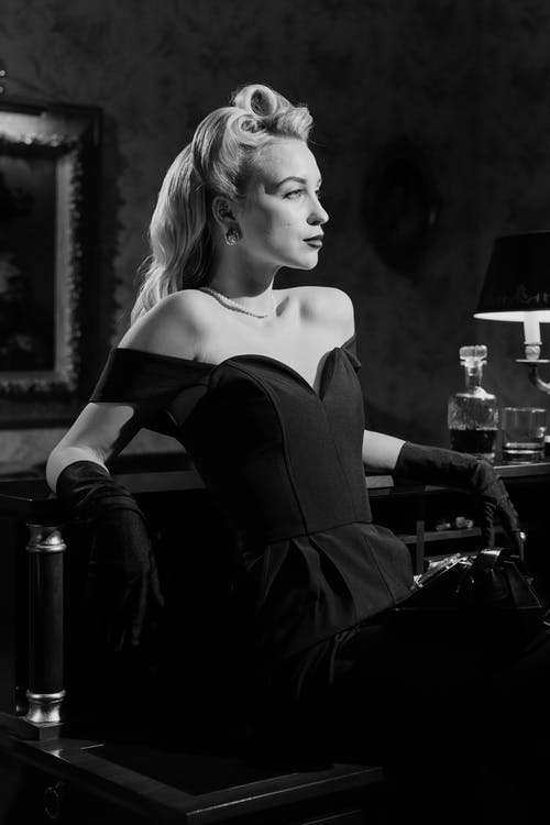 Woman With Blonde Hair In Black Dress