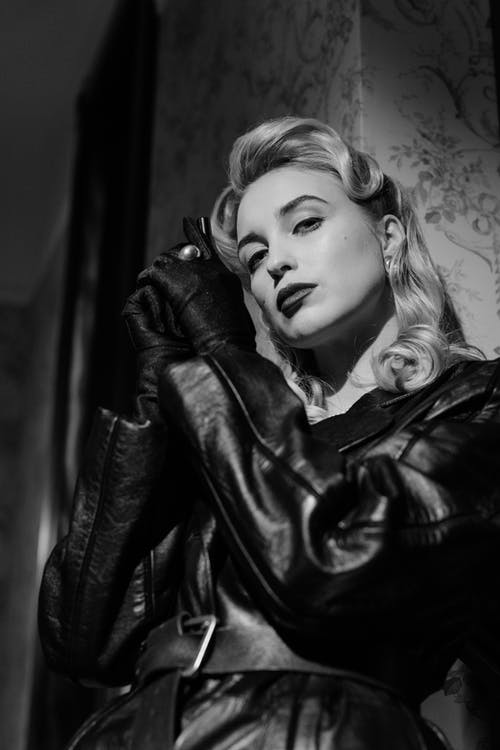 Low Angle Shot of Woman in Leather Coat