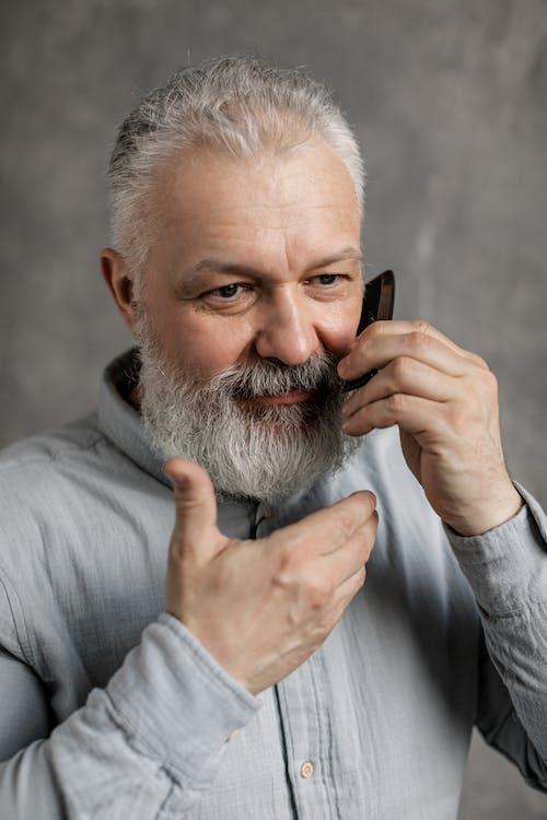 Elderly Man Combing His Beard