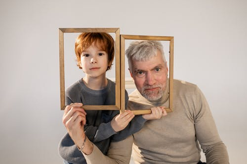 Grandfather and Grandson Having Fun with Frames