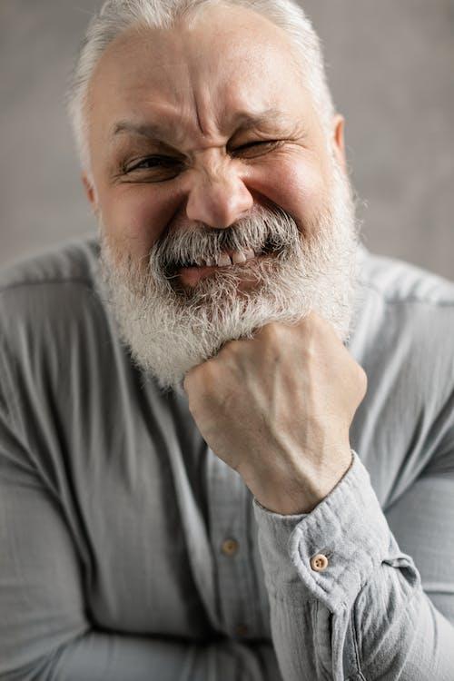 Elderly Man in Gray Long Sleeves Winking
