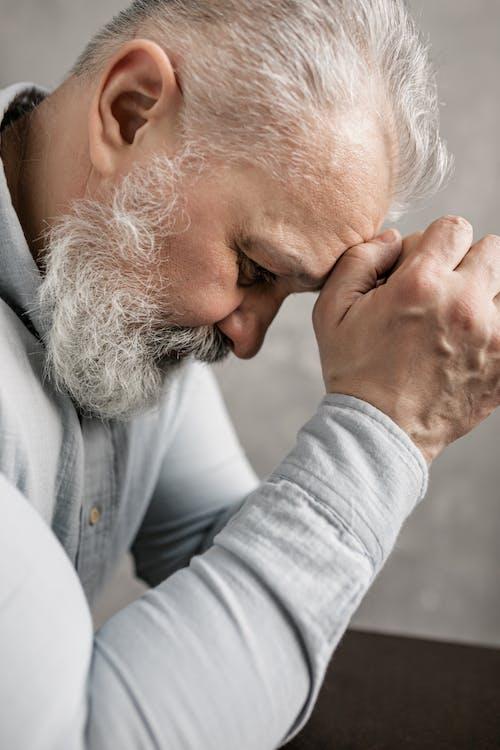 Elderly Man in Gray Long Sleeve Shirt Thinking Deeply