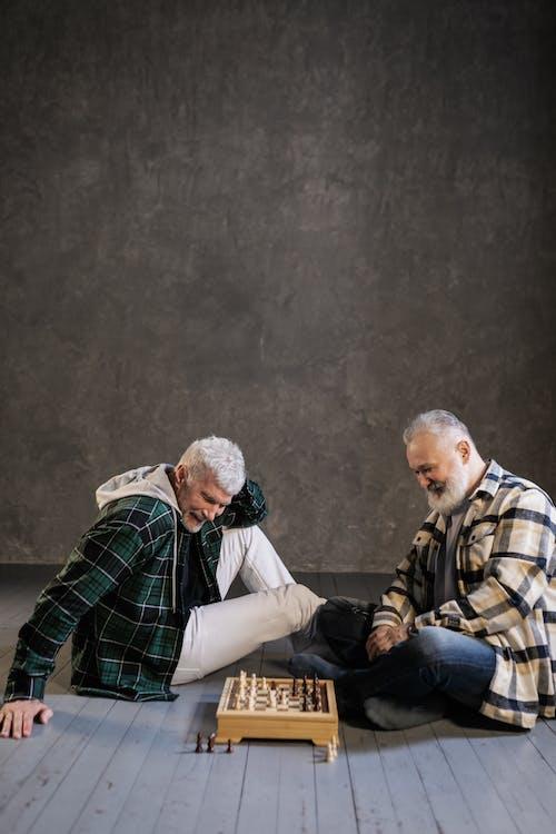 Elderly Men Playing Chess