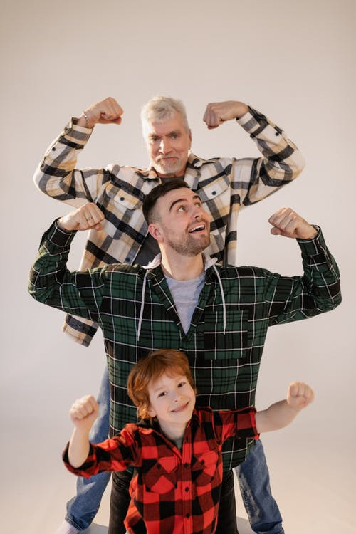 A Family Showing Off Their Muscles