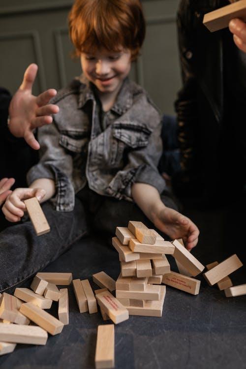 A Family Playing Jenga