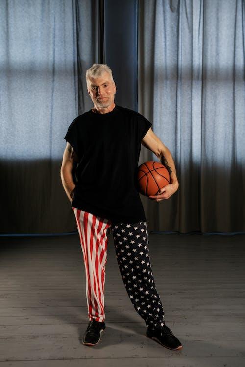 Elderly Man Holding a Basketball