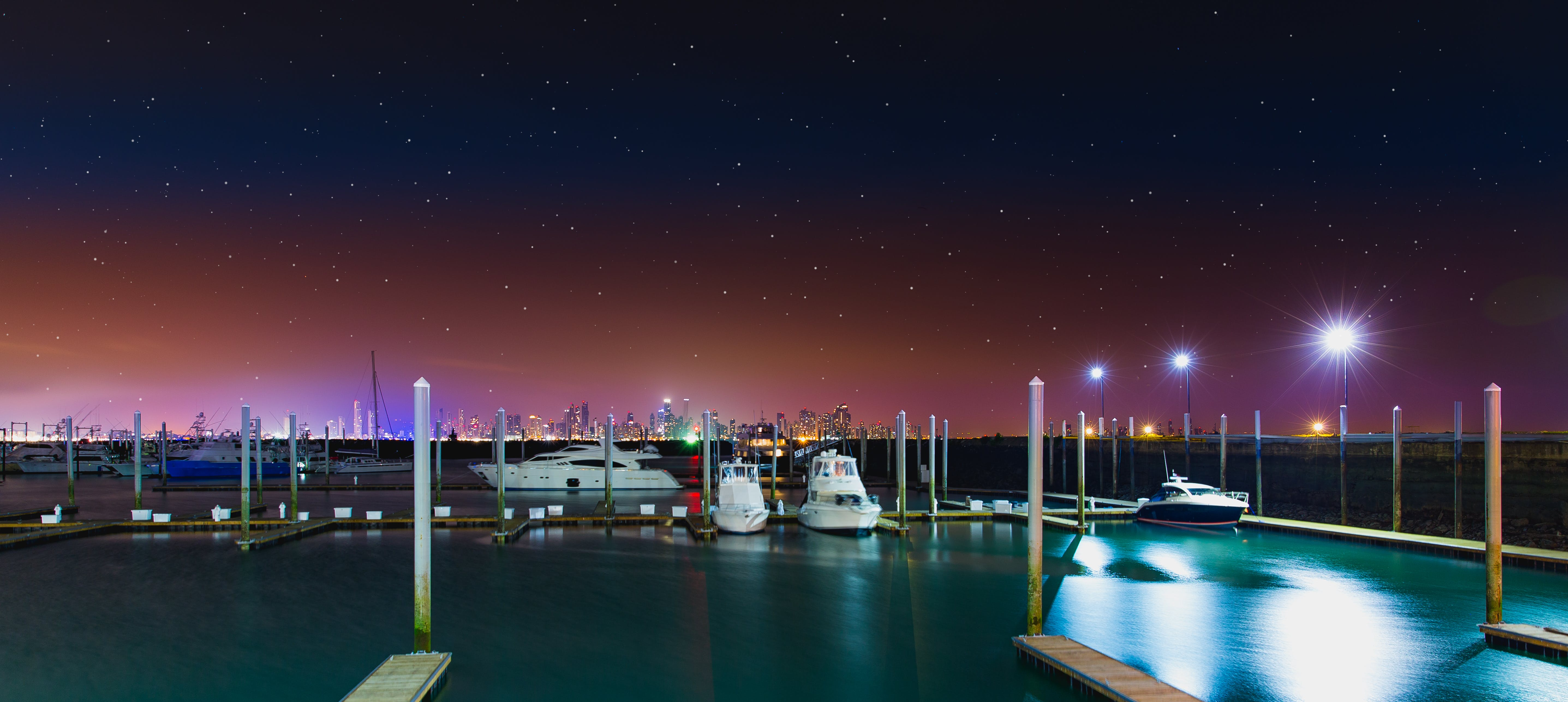 White Yacht at the Dock during Nighttime