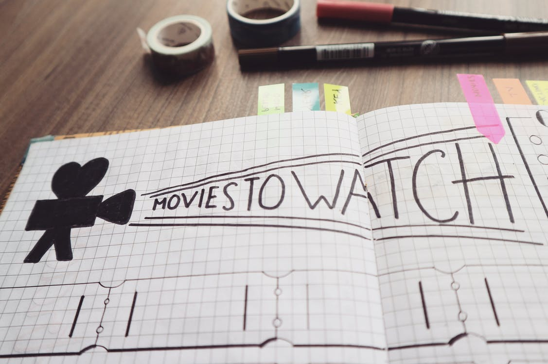Free stock photo of bullet journal, movies to watch, pen
