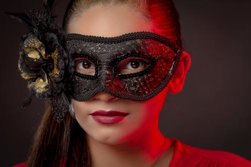 Woman in Black and White Floral Mask