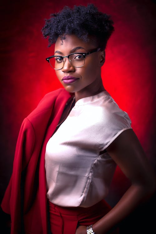 Woman in White Shirt and Red Blazer Wearing Eyeglasses