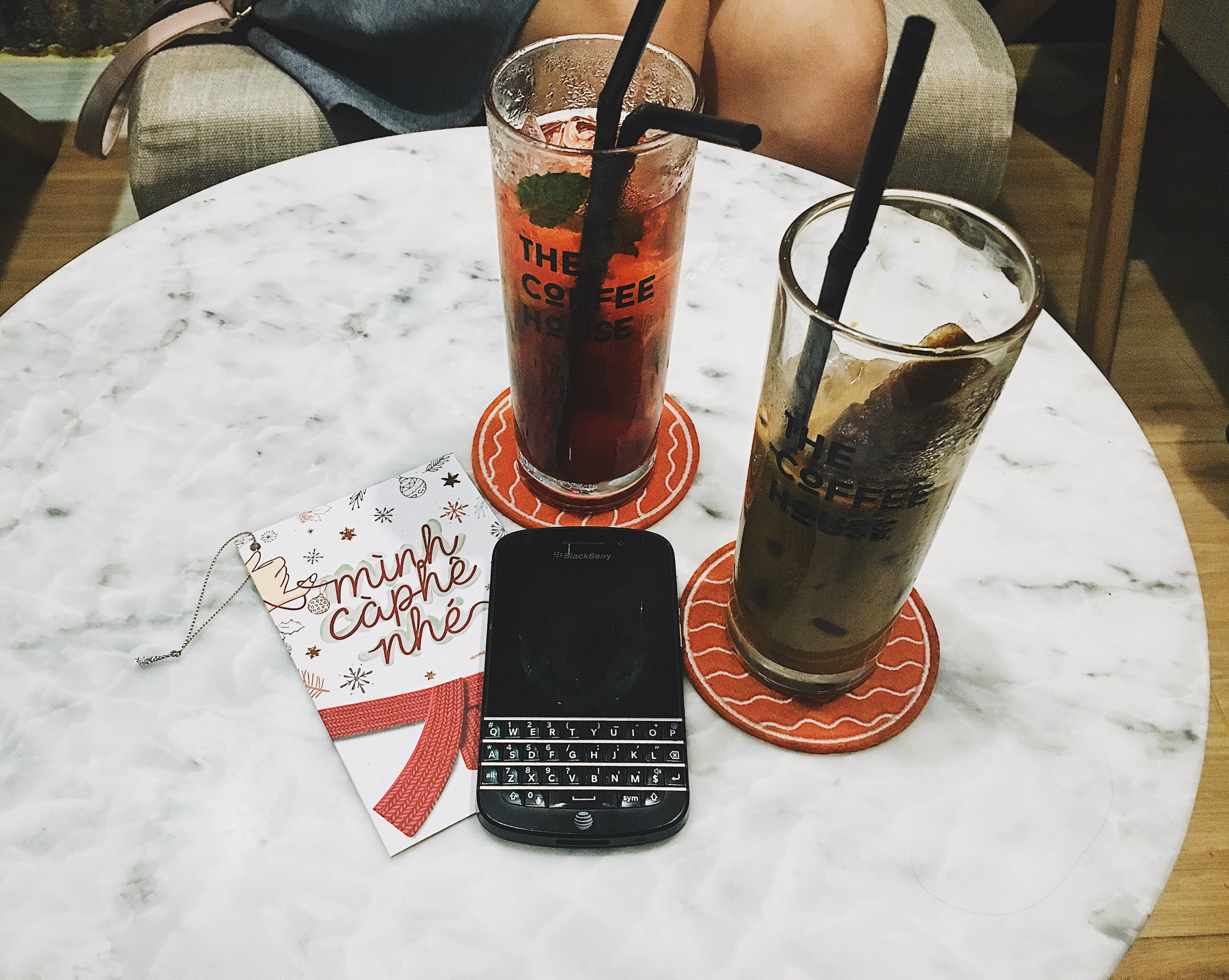Photo of Blackberry Phone Beside Two Tall Glasses