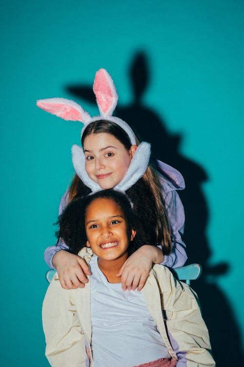 Smiling Girls Wearing Bunny Ears