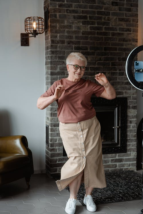 Woman Dancing In Front of a Phone