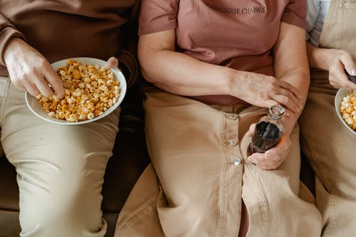 Person Holding a Bowl with Popcorn