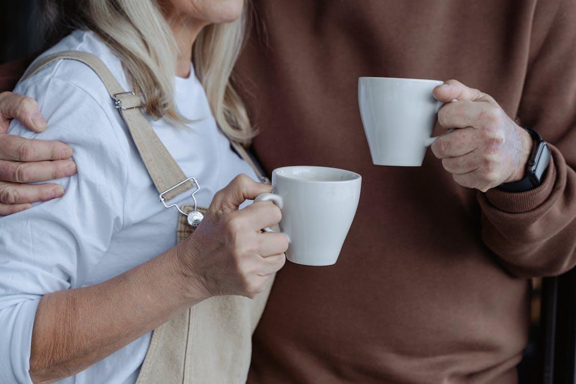 People Holding White Mugs