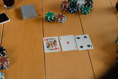 White Playing Cards on Brown Wooden Floor