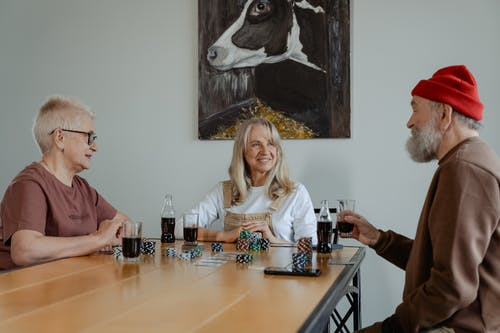 People Sitting at the Table Playing