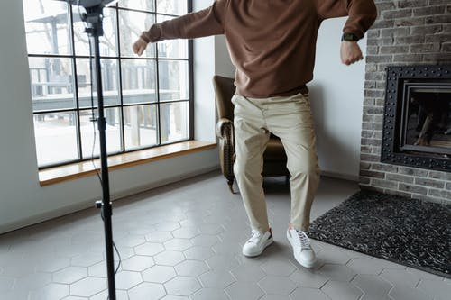 Man in Brown Sweater Dancing
