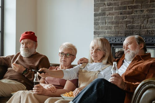 People Sitting on a Sofa