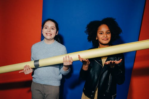 Girls Holding a Backdrop