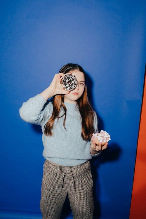 Girl Holding Doughnuts