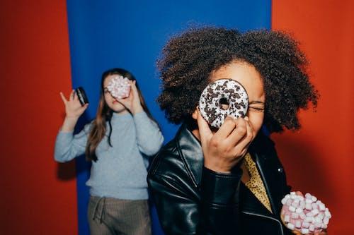 Girls Holding Doughnuts