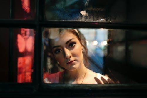 Through window of charming woman