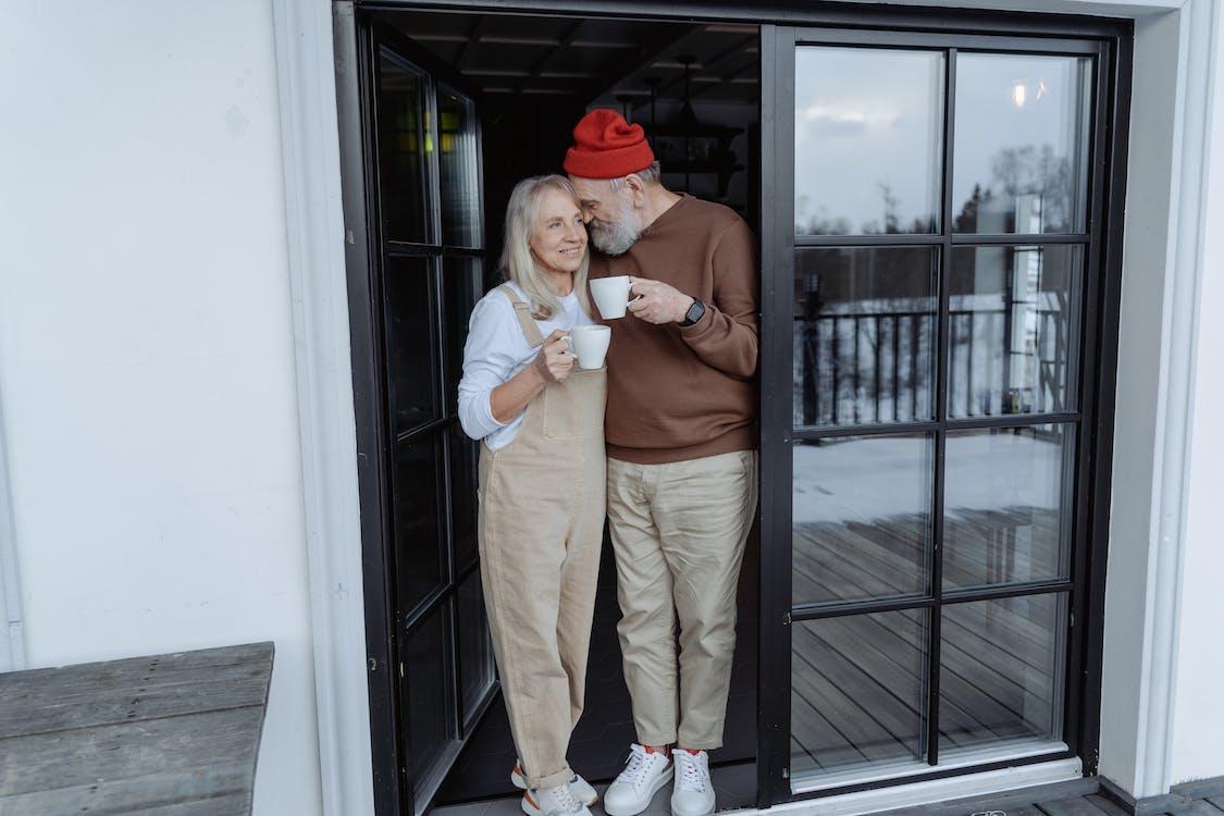 Couple Standing by the Door