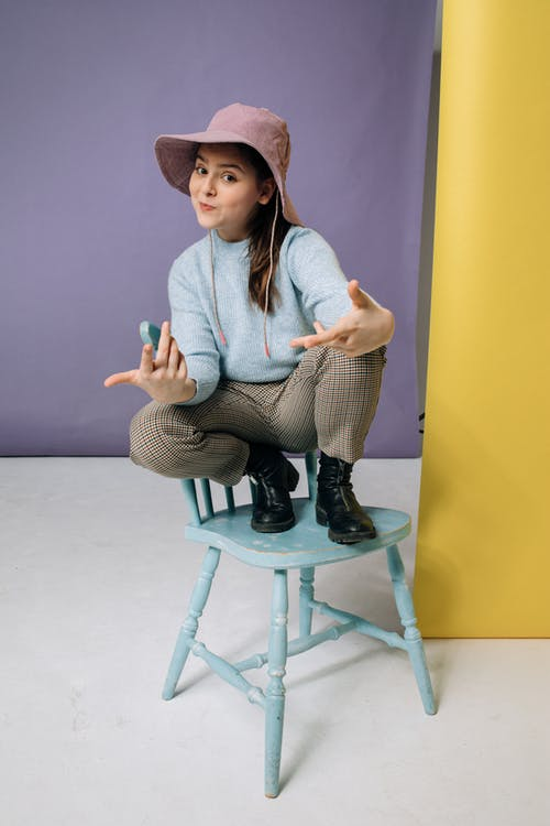 Girl Wearing a Long Sleeve Top and a Hat
