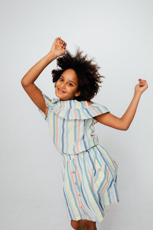Girl in Stripe Dress Dancing