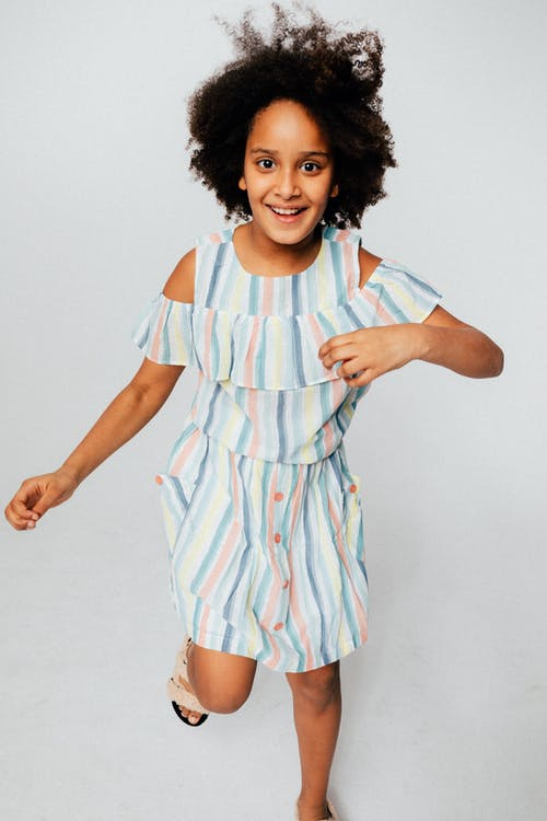 Girl Wearing A Striped Dress Smiling