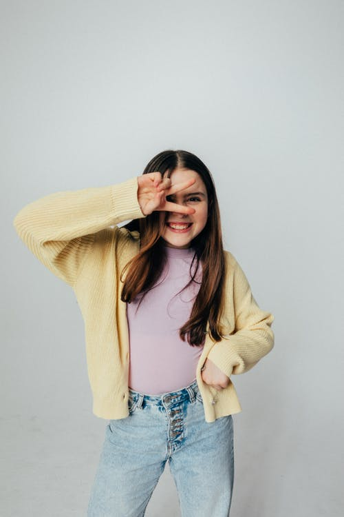 Girl in Yellow Sweater and Denim Jeans