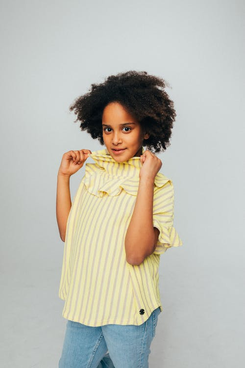 Girl in Yellow and White Stripe Top