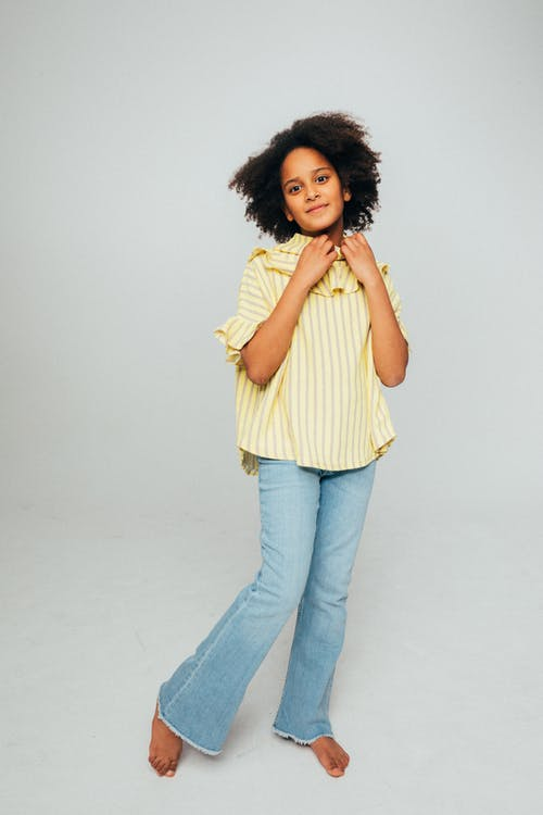 Girl Wearing a Yellow Top and Denim Jeans