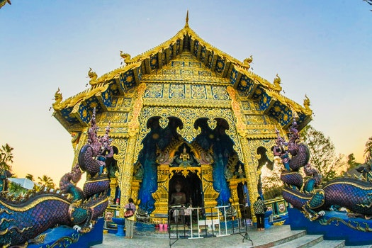 Photo of Gold-colored Altar With Dragon Figurines