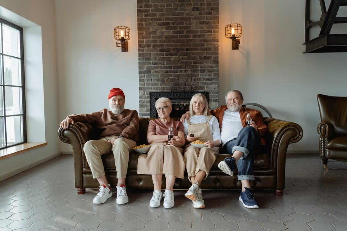 People Sitting on Brown Leather Sofa