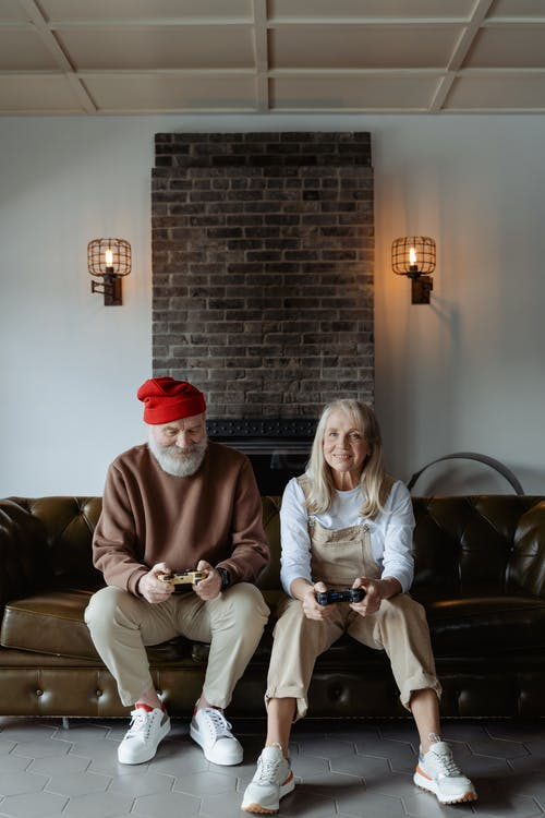 Man and Woman Sitting on a Sofa