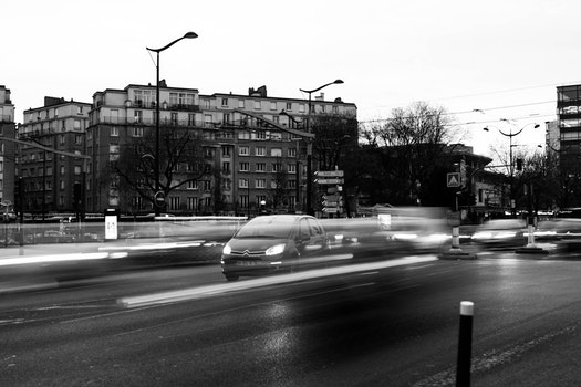Vehicles on Road in Grayscale Photography