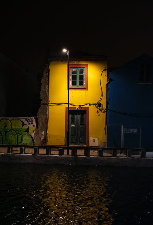 Free stock photo of water canal, yellow house