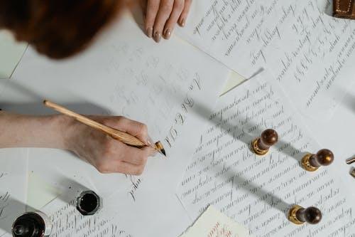 Gratis arkivbilde med blekk, flatlay, håndskrift